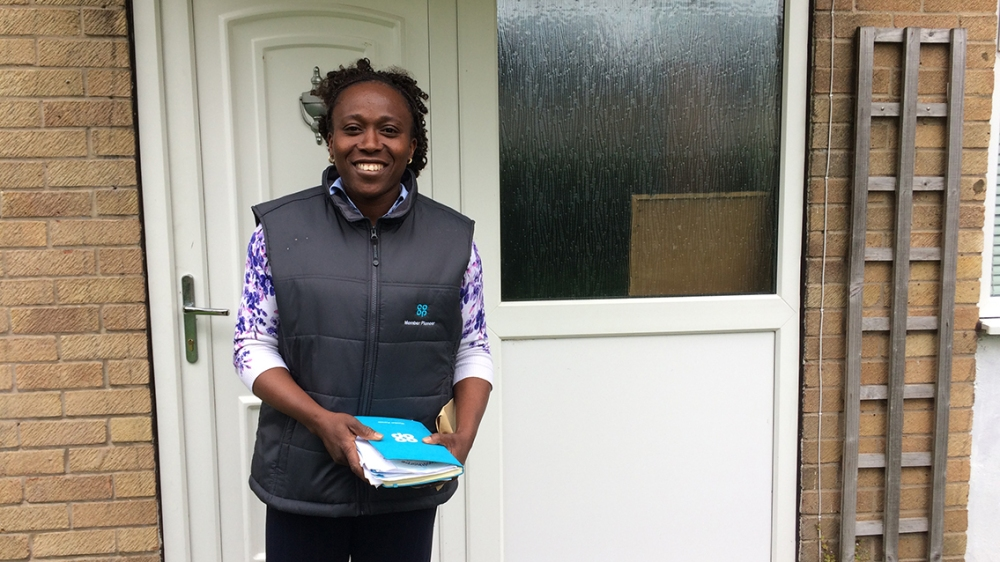 Abimbola, Member Pioneer for York, outside her home