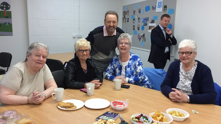 Steve in Crown Street's community room with the ladies from the Gorbalites, a local cause supported by our Co-op