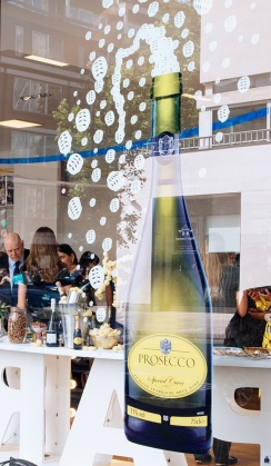 Giant decal of a Prosecco bottle on the window