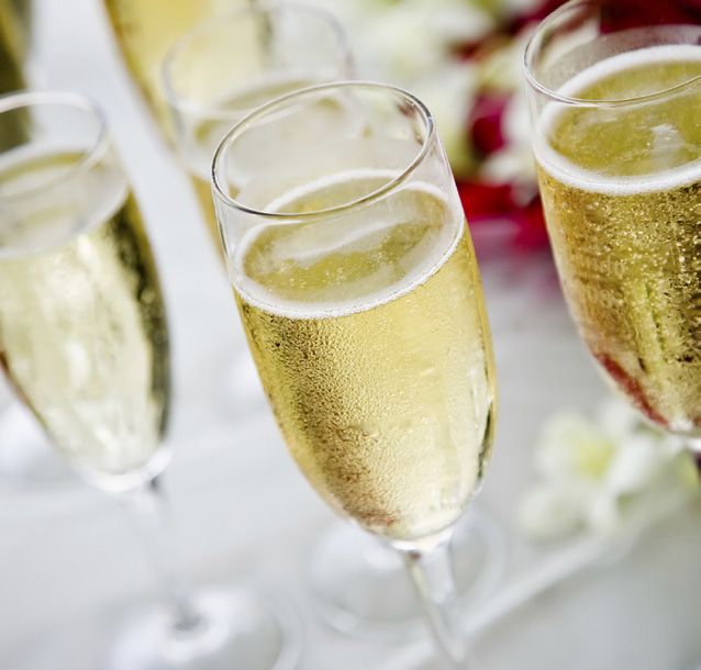 Image of champagne glasses filled with champagne
