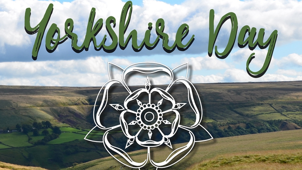 Landscape in Yorkshire with the white rose and Yorkshire Day written over the top