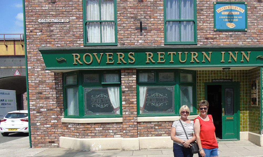 Colleagues Tracey and Michelle outside the Rovers Return Inn