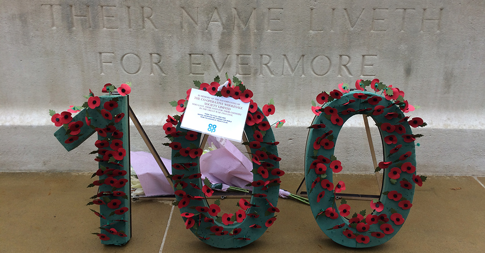 100 of poppies laid on Manchester war memorial in memory of the 810 CWS fallen