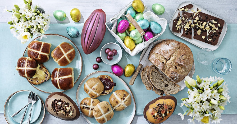 a selection of hot cross buns and easter eggs