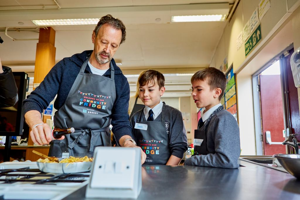 Steve Murrells cooking with pupils at Co-op's Failsworth Academy